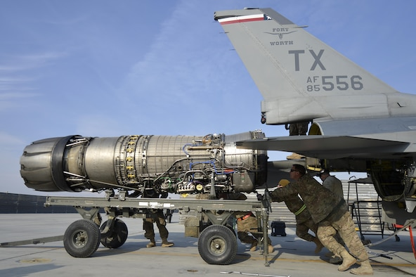 Airmen assigned to the 455th Expeditionary Aircraft Maintenance Squadron remove the engine from an F-16 Fighting Falcon Jan. 22, 2014, at Bagram Airfield, Afghanistan. The engine was removed due to a defective hydraulic line. (U.S. Air Force photo/Senior Airman Kayla Newman)