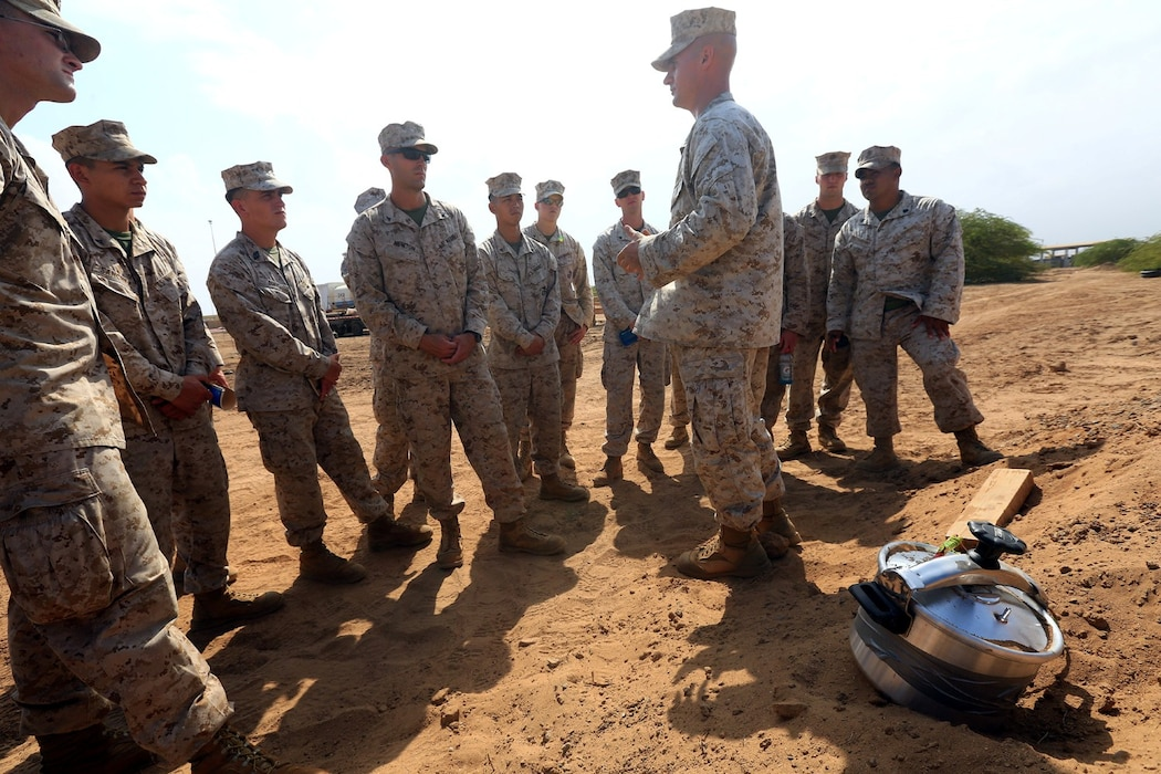CAMP LEMONNIER, DJIBOUTI (Jan. 10, 2014)  – U.S. Marine Corps Gunnery Sgt. Patrick Hilty, staff noncommissioned officer-in-charge of Explosive Ordnance Disposal Detachment, 13th Marine Expeditionary Unit, discusses the properties of an improvised explosive device (IED) made from a pressure cooker during counter IED training at Camp Lemonnier, Djibouti Jan. 10, 2014. Approximately 50 Marines assigned to Charlie Company, 13th MEU completed counter IED training, which covered a wide variety of techniques to defeat enemy IEDs. The 13th MEU is deployed with the Boxer Amphibious Ready Group as a theater reserve and crisis response force throughout the U.S. 5th Fleet area of responsibility.  (U.S. Marine Corps photo by Staff Sgt. Matt Orr/Released)