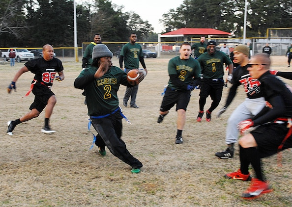 Immortals tailback Travis Phillips sprints to gain a few yards for his team during Marine Corps Logistics Base Albany's Intramural Flag Football Tournament, Jan. 24.