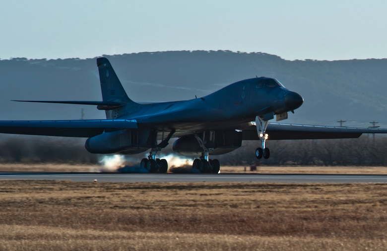 The first newly upgraded operational B1-B Lancer lands Jan. 21, 2014, at Dyess Air Force Base, Texas. The B-1B Lancer was recently upgraded with a new Integrated Battle Station. The new system includes a combination of three different upgrades. One major upgrade incorporates a modern datalink communication network that allows real-time communication with other aircraft, ground stations, and allied forces. The data link also enhances crew awareness of the battle space, and allows for quicker targeting. (U.S. Air Force photo by Staff Sgt. Richard Ebensberger/Released)