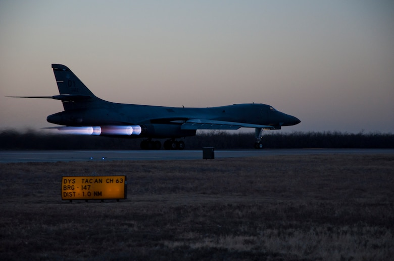 The first newly upgraded operational B1-B Lancer prepares to take flight Jan. 21, 2014, at Dyess Air Force Base, Texas. The B-1B Lancer was recently upgraded with a new Integrated Battle Station. The IBS is a combination of three different upgrades, which include a Fully Integrated Data Link, a Vertical Situation Display upgrade, and a Central Integrated System upgrade. Developmental testing was conducted at Edwards AFB, Calif. and the 337th Test and Evaluation Squadron will now began operational testing at Dyess. (U.S. Air Force photo by Staff Sgt. Richard Ebensberger/Released)
