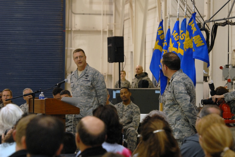 U.S. Air Force Col. Roger E. Williams, commander of the 145th Airlift Wing, gives accolades to Vice-Wing Commander, Col Quincy N. Huneycutt, during a Change of Command ceremony. Huneycutt relinquished his command of the 145th Mission Support Group. The CoC ceremony was at the North Carolina Air National Guard base, Charlotte-Douglas Intl. airport, Jan. 11, 2014. (U.S. National Guard photo by Senior Airman Laura Montgomery/Released)