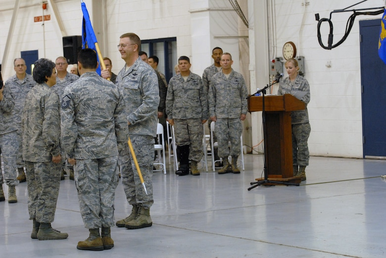 U.S. Air Force Col. Barbara Doncaster assumes command of the 145th Mission Support Group by accepting guidon from Col. Roger E. Williams, Jr., commander 145th Airlift Wing, during a Change of Command ceremony held at the North Carolina Air National Guard base, Charlotte-Douglas Intl. airport, Jan. 11, 2014. In addition to the men and women of the 145th AW, several leaders were also in attendance including Maj. Gen. Robert Stonestreet, ANG assistant to the commander, Air Force Space Command; Brig. Gen. Todd D. Kelly, N.C. assistant adjutant general- Air  and Col. Clarence Ervin, NCANG, Director of Staff - Air (U.S. Air National Guard photo by Senior Airman Laura Montgomery/Released)