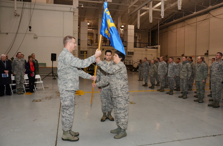 U.S. Air Force Col. Barbara Doncaster assumes command of the 145th Mission Support Group by way of accepting guidon from Col. Roger E. Williams, Jr., commander 145th Airlift Wing, during a Change of Command ceremony held at the North Carolina Air National Guard base, Charlotte-Douglas Intl. airport, Jan. 11, 2014. The traditional handing over of the guidon signifies the relief and acceptance of duty between two individuals from the base commander. It also allows for the accepting commander to be welcomed by their troops, as well as the departing commander to give their 'thank you' and farewell. (U.S. Air National Guard photo by Master Sgt. Patricia F. Moran/Released)