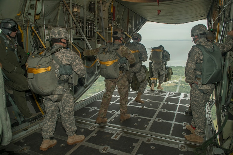 Paratroopers from the U.S. Army, Navy, Maries, and Air Force do a static line jump from a C-130H2 aircraft belonging to the 136th Airlift Wing, Texas Air National Guard during a joint airborne air transportability training at McDill AFB, Fla., Nov. 15, 2013. The paratroopers jumped from 1,000 feet above ground level. . (Air National Guard photo by Senior Master Sgt. Elizabeth Gilbert/released)