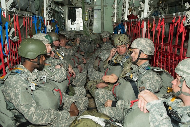 Paratroopers from the U.S. Army, Navy, Marines and Air Force prepare to do a static line jump from a C-130H2 aircraft belonging to the 136th Airlift Wing, Texas Air National Guard during a joint airborne air transportability training at McDill AFB, Fla., Nov. 15, 2013. The paratroopers jumped from 1,000 feet above ground level. (Air National Guard photo by Senior Master Sgt. Elizabeth Gilbert/released)