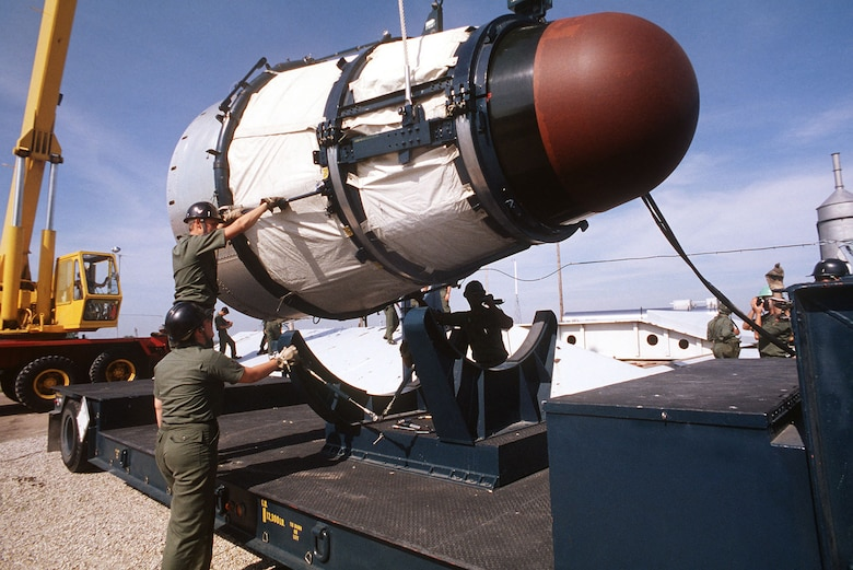 Maintenance personnel removing the Mk-6 re-entry vehicle from a Titan II missile. (U.S. Air Force photo)