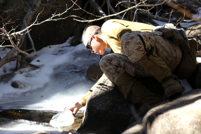 A Marine with 2nd Battalion, 2nd Marine Regiment, 2nd Marine Division, collects water from a mountain stream during a hike at the Marine Corps Mountain Warfare Training Center in Bridgeport, Calif. To gain an expeditionary mindset the Marines and Sailors of 2nd Battalion, 2nd Marines and Ragnarok Co., 2nd Marine Logistics Company, conducted a 10-day field exercise, which consisted of long range day and night foot movement through extremely rugged terrain with drastic elevation changes and tested the Marines' endurance.