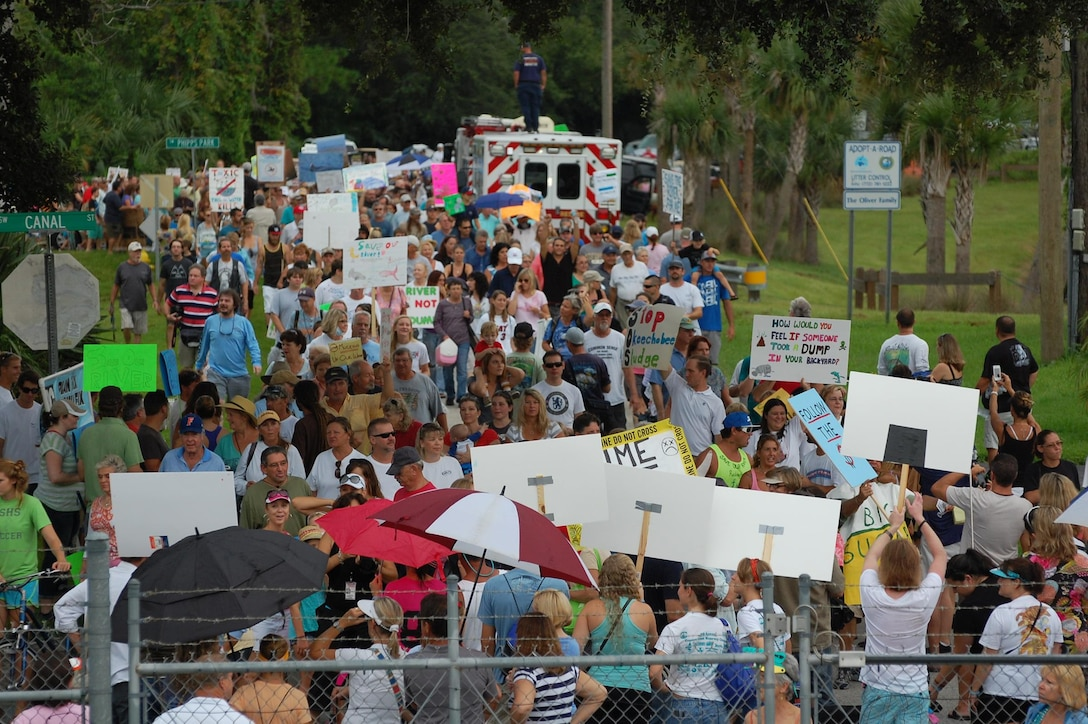 An estimated 5,000 protesters march near the St. Lucie Lock August 3 to demonstrate opposition to water releases from Lake Okeechobee. Jacksonville District's Operations Division released water from the lake throughout the summer in response to heavy precipitation that fell from April to July in the Lake Okeechobee watershed.