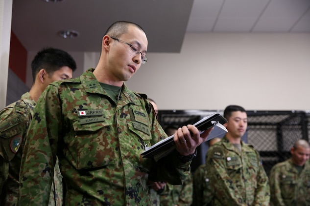 A soldier with the Japan Ground Self-Defense Force introduces himself to Marines from !st Air Naval Gunfire Liaison Company during Exercise Iron Fist 2014 aboard Camp Pendleton, Calif., Jan. 23, 2014. Iron Fist 2014 is an amphibious exercise that brings together Marines and sailors from the 15th Marine Expeditionary Unit, other I Marine Expeditionary Force units, and soldiers from the JGSDF, to promote military interoperability and hone individual and small-unit skills through challenging, complex and realistic training. (U.S. Marine Corps photo by Lance Cpl. Anna K. Albrecht/Released)