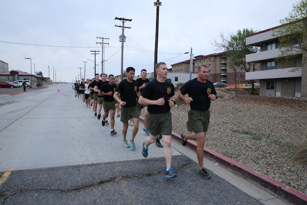 U.S. Marines from 1st Air Naval Gunfire Liaison Company and soldiers from the Japan Ground Self-Defense Force run for morning physical training during Exercise Iron Fist 2014 aboard Camp Pendleton, Calif., Jan. 24, 2014. Iron Fist 2014 is an amphibious exercise that brings together Marines and sailors from the 15th Marine Expeditionary Unit, other I Marine Expeditionary Force units, and soldiers from the JGSDF, to promote military interoperability and hone individual and small-unit skills through challenging, complex and realistic training. (U.S. Marine Corps photo by Lance Cpl. Anna K. Albrecht/Released)
