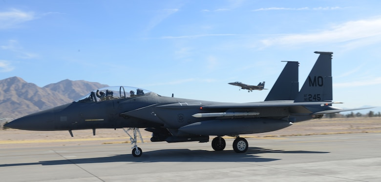 An F-15E Strike Eagle pilot cheers while going along the flightline as another F-15 comes in for a landing Jan 26, 2014, at Nellis ir Force Base, Nev. The 391st Fighter Squadron is at Nellis to participate in Red Flag 14-1 Jan. 27 to Feb. 14. (U.S. Air Force photo by Senior Airman Benjamin Sutton/Released)