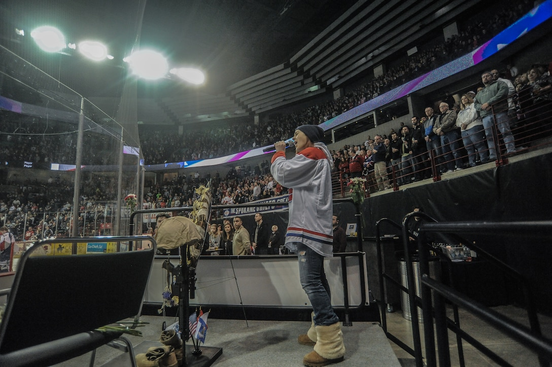 U.S. Air Force Staff Sgt. Brittany Ward (far right) sings 'God Bless America' at Spokane Arena during the Spokane Chiefs Military Appreciation Night Jan. 26, at Spokane, Wash. (U.S. Air Force photo by Staff Sgt. Alexandre Montes/RELEASED)