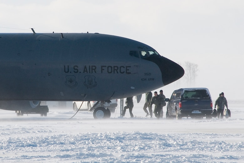 An aircrew prepares to board a KC-135R Stratotanker at Grissom Air Reserve Base, Ind., Jan. 25, 2014. After historic January snowfalls, civilian contractors have had to work hard to clear snow from Grissom's flightline so aircraft could continue to take off. (U.S. Air Force photo/Staff Sgt. Andrew McLaughlin)