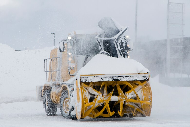 Dave Smith, a civilian contractor, uses an industrial snow blower to remove snow from an airfield at Grissom Air Reserve Base, Ind., Jan. 25, 2014. Grissom's snow-control team has cleared more than 30 inches of snow that have fallen on the base's flightline this month. (U.S. Air Force photo/Staff Sgt. Andrew McLaughlin)