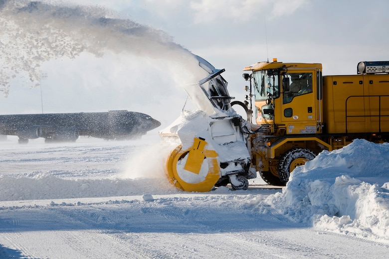Dave Smith, a civilian contractor, removes snow from an airfield using an industrial snow blower at Grissom Air Reserve Base, Ind., Jan. 25, 2014. The base snow-control team has cleared more than 30 inches of snow that have fallen on Grissom's flightline this month. (U.S. Air Force photo/Staff Sgt. Andrew McLaughlin)