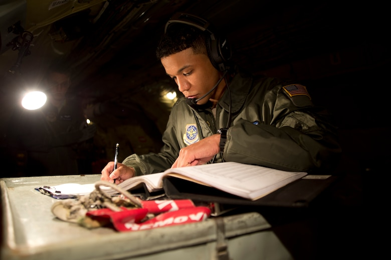 Airman 1st Class Kyle Jackson, 344th Air Refueling Squadron boom operator apprentice, goes over a preflight checklist Jan. 15, 2014, at McConnell Air Force Base, Kan. He is evaluated on his performance by an instructor boom operator. Each passed evaluation brings Jackson closer to becoming a boom operator journeyman. (U.S. Air Force photo/Airman 1st Class John Linzmeier)