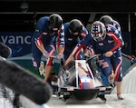 Former U.S. Army World Class Athlete Program bobsledder Steven Holcomb (front right) leads
