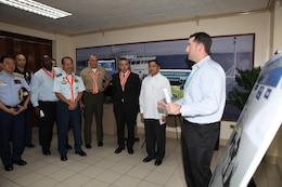 Chad Teegardin (right), contractor for Special Surveillance Programs at Naval Air Systems, explains the capabilities of the Maritime Persistent Surveillance Tower system to senior Philippine and U.S. officials during the initial maritime domain awareness demonstration at the Philippine Coast Guard Headquarters in Manila, Philippines, Jan. 27. The MPST is a land-based, mobile, multi-sensor payload platform that supports persistent 360-degree surveillance operations. The MPST detects and monitors surface contacts operating in the littorals, with various advanced sensors. The system is tailorable to meet specific requirements and mission parameters.