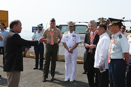 Rick DeGuzman (left), deputy assistant chief of staff for operations at U.S. Marine Corps Forces, Pacific, escorts senior Philippine and U.S. officials during the initial maritime domain awareness demonstration at the Philippine Coast Guard Headquarters in Manila, Philippines, Jan. 27. Initiatives like the maritime domain awareness experiment help to maintain a high level of interoperability, enhance our military-to-military relations, and improve our combined capabilities.