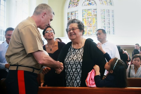 "Marine Brig. Gen. Paul Kennedy, deputy commanding general of III Marine Expeditionary Force and commanding general of 3rd Marine Expeditionary Brigade in Okinawa, Japan, offers condolences to Patricia Blaz Borja, the sister of retired Marine Brig. Gen. Vincente ""Ben"" T. Blaz, during a service Jan. 18 to honor Blaz, who died Jan. 8 at the age of 85. (Official U.S. Marine Corps photo by Sgt. John Raufmann)"