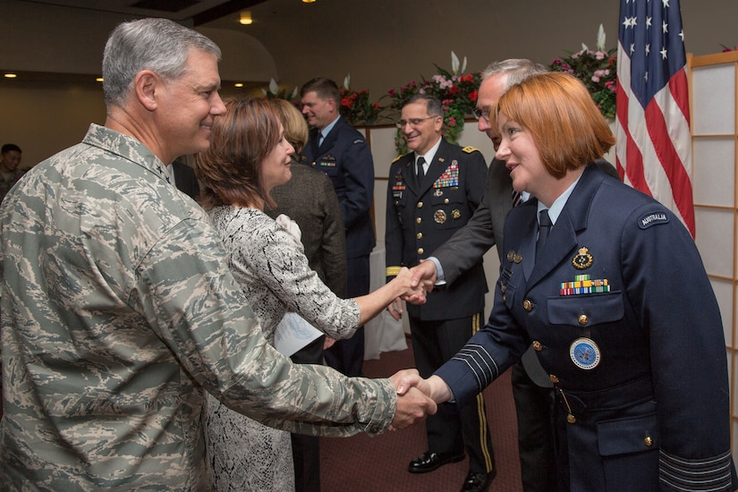 (Left to right) U.S. Air Force Lt. Gen. Sam Angelella, the commander of U.S. Forces Japan and the 5th Air Force, greets Royal Australia Air Force Group Captain Barbara Courtney, United Nations Command (Rear) commander, after the UNC (Rear) change of command ceremony at Yokota Air Base, Japan, Jan. 28, 2014. As the United Nations Command's principal representative in Japan, the UNC (Rear) maintains the status of forces agreement regarding United Nations Forces in Japan during armistice conditions. (U.S. Air Force photo by Osakabe Yasuo/Released)