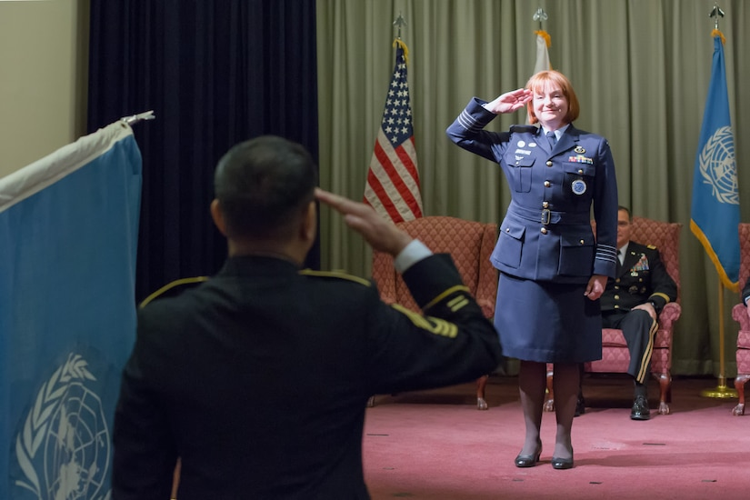 Royal Australia Air Force Group Captain Barbara Courtney, United Nations Command (Rear) commander, renders her first salute as commander during the UNC (Rear) change of command ceremony at Yokota Air Base, Japan, Jan. 28, 2014. Courtney assumed command from Royal Australia Air Force Group Captain Luke Stoodley. (U.S. Air Force photo by Osakabe Yasuo/Released)