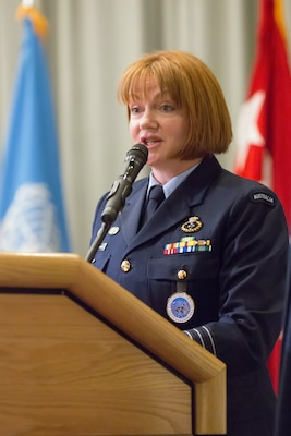 Royal Australia Air Force Group Captain Barbara Courtney, United Nations Command (Rear) commander, gives a speech during the UNC (Rear) change of command ceremony at Yokota Air Base, Japan, Jan. 28, 2014. As the United Nations Command's principal representative in Japan, the UNC (Rear) maintains the status of forces agreement regarding United Nations Forces in Japan during armistice conditions. (U.S. Air Force photo by Osakabe Yasuo/Released)