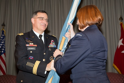 (Right to left) Royal Australia Air Force Group Captain Barbara Courtney, incoming United Nations Command (Rear) commander, receives the guidon from U.S. Army Gen. Curtis Scaparrotti, commander of the United Nations Command, Combined Forces Command, and U.S. Forces Korea, during a change of command ceremony at Yokota Air Base, Japan, Jan. 28, 2014. As the UNC's principal representative in Japan, the UNC (Rear) maintains the status of forces agreement regarding United Nations Forces in Japan during armistice conditions. (U.S. Air Force photo by Osakabe Yasuo/Relased)