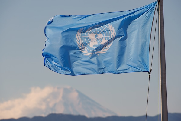 The United Nations flag waves at Yokota Air Base, Japan, Jan. 10, 2014. Yokota AB is one of the United Nation Command bases, under the UNC-Japan Status of Forces Agreement (SOFA) Decrees. (U.S. Air Force photo by Osakabe Yasuo/Released)