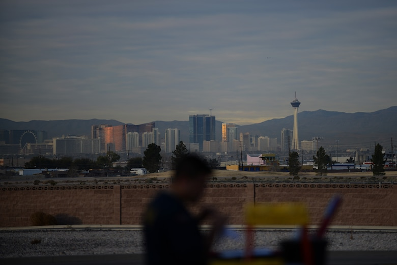 The fabulous Las Vegas skyline is unmistakable from the Nellis Air Force Base, Nev., flight line Jan. 28, 2014. One of the many great aspects of the multinational combat exercise Red Flag 14-1 is the opportunities Airmen from across the globe have once their work day is complete. Red Flag began back in 1975 and provides aircrew realistic, stressful situations to deal with in a controlled environment. (U.S. Air Force photo by Senior Airman Benjamin Sutton/Released)