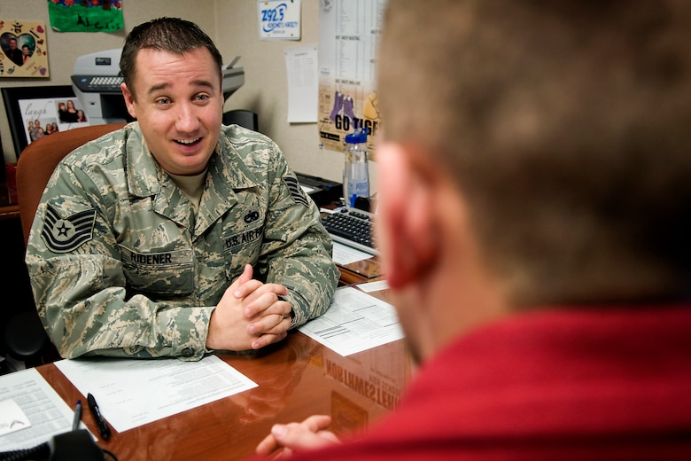 U.S. Air Force Tech. Sgt. Craig Ridener, 434th Air Refueling Wing recruiter, talks with U.S. Army National Guard Pvt. 1st Class Mitchell Wooten, about opportunities in the Air Force Reserve at Grissom Air Reserve Base, Ind., Jan. 15, 2014. The Air Force Reserve Command is now actively seeking Airmen who want to serve as full-time recruiters on active-guard and reserve tours. (U.S. Air Force photo/Tech. Sgt. Mark R. W. Orders-Woempner)