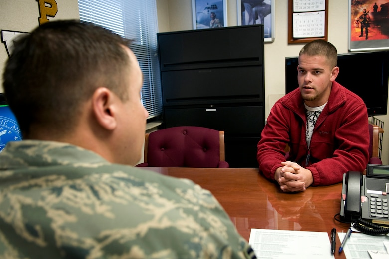 U.S. Army National Guard Pvt. 1st Class Mitchell Wooten talks with U.S. Air Force Tech. Sgt. Craig Ridener, 434th Air Refueling Wing recruiter, as he inquires about opportunities in the Air Force Reserve at Grissom Air Reserve Base, Ind., Jan. 15, 2014. The Air Force Reserve Command is now actively seeking Airmen who want to serve as full-time recruiters on active-guard and reserve tours. (U.S. Air Force photo/Tech. Sgt. Mark R. W. Orders-Woempner)