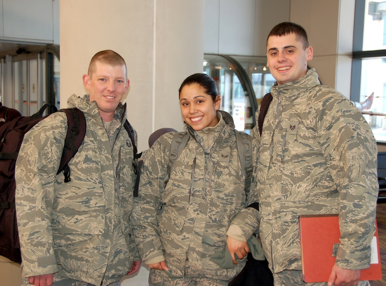Master Sgt. Chris Jones, Senior Airman Vanessa Hernandez, and Staff Sgt. Vitaliy Gorbachyk,  three Airmen from the 103rd Force Support Squadron at Bradley Air National Guard Base, East Granby, Conn., said farewell to their loved ones and boarded an aircraft bound for a deployed location in Southwest Asia on Jan. 23, 2014.  (U.S. Air National Guard photo by Maj. Bryon M. Turner)
