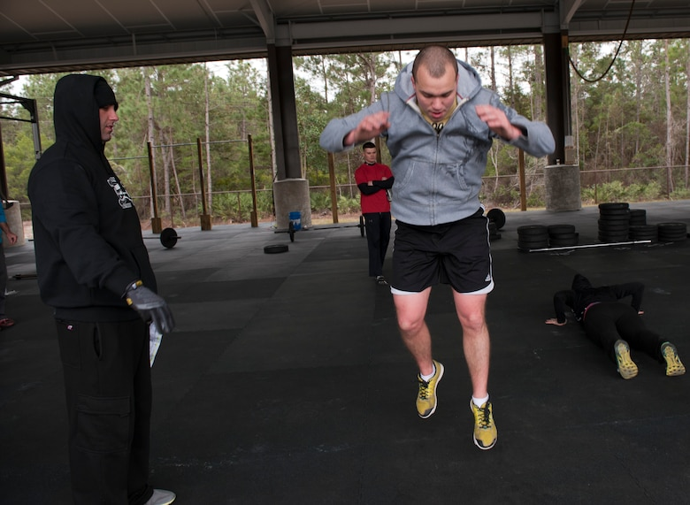 Senior Airman Braden Irby, 1st Special Operations Communications Squadron unit deployment manager, performs a burpee exercise during the King and Queen of the Gym compettion at Hulrburt Field, Fla., Jan. 24, 2014. A burpee is a full-body exercise which consist of going to and from a pushup position then leaping in the air. (U.S. Air Force photo/Senior Airman Krystal M. Garrett)