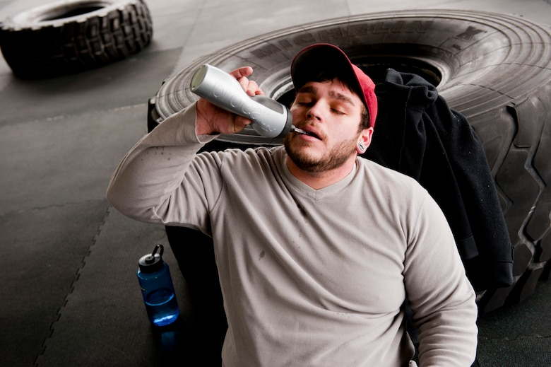 Michael Irby, a competitor at the King and Queen of the Gym, takes a break to hydrate at Hurlburt Field, Fla., Jan. 24, 2014. Participants completed three rounds of CrossFit exercises during the competition. (U.S. Air Force photo/Senior Airman Krystal M. Garrett)