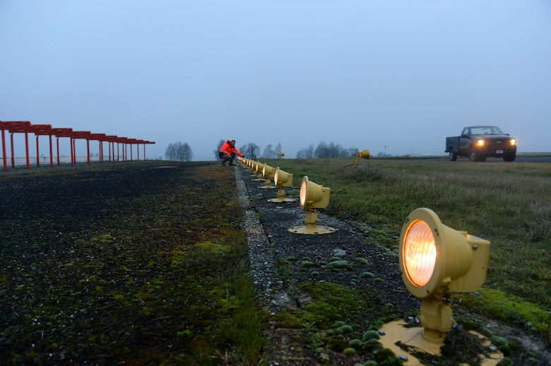 U.S. Air Force Senior Airman Aaron Demmon, a 52nd Civil Engineer Squadron electrical systems journeyman from Ludington, Mich., inspects strobe lights on the airfield at Spangdahlem Air Base, Germany, Jan. 23, 2014. Demmon and his two other team members inspect all the lights on the airfield to include the runway, and all taxi ways. (U.S. Air Force photo by Senior Airman Rusty Frank/Released)