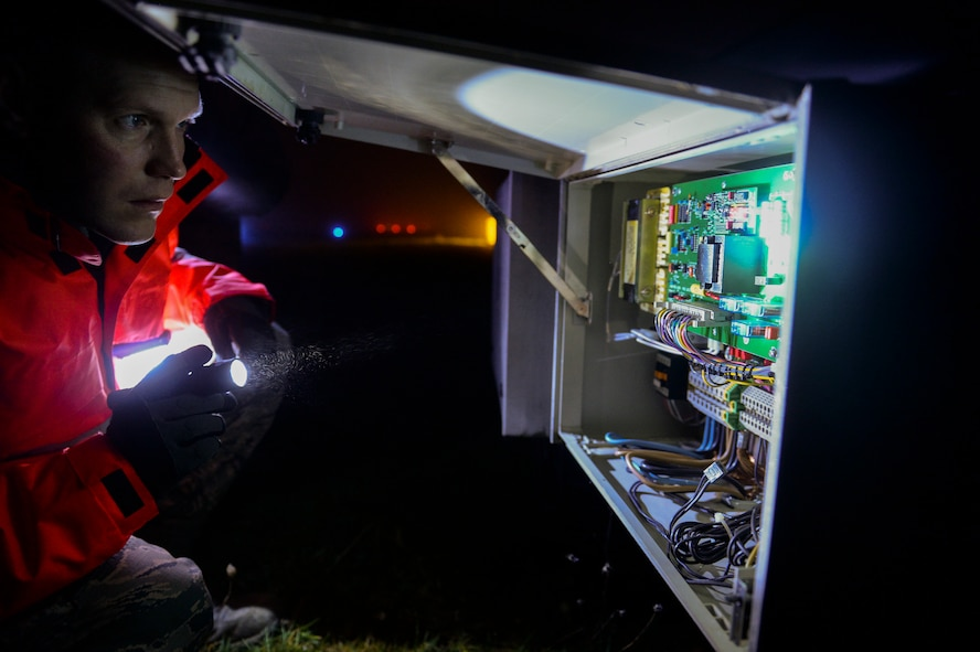 U.S. Air Force Senior Airman Aaron Demmon, a 52nd Civil Engineer Squadron electrical systems journeyman from Ludington, Mich., checks a circuit panel on for maintenance on a strobe light on the airfield at Spangdahlem Air Base, Germany Jan. 23, 2014. Demmon checked the circuit panel to find a way to troubleshoot a broken strobe on the airfield. (U.S. Air Force photo by Senior Airman Rusty Frank/Released)