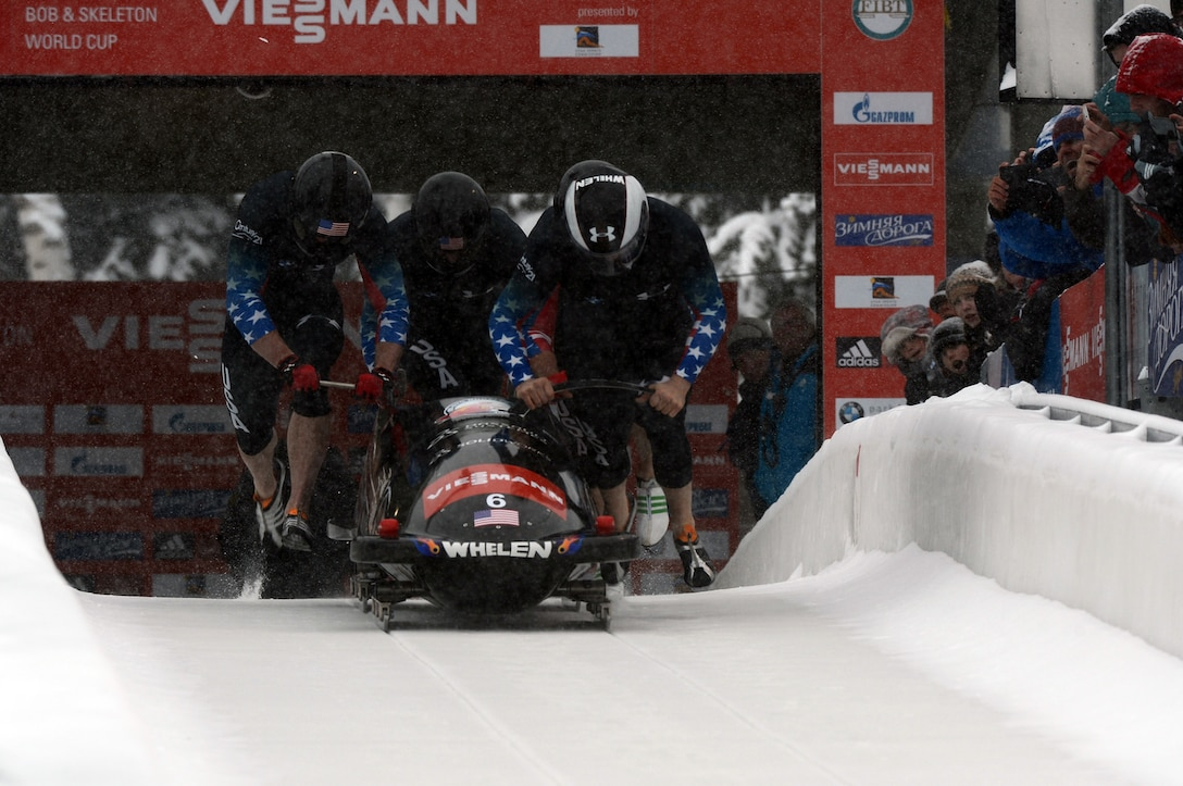 Former U.S. Army World Class Athlete Program bobsled driver Steven Holcomb (right) teams with Curtis Tomasevicz, Steven Langton and WCAP brakeman Capt. Christopher Fogt to win the four-man bobsled event at the International Bobsled & Skeleton Federation's 2013 World Cup stop Dec. 7 at Utah Olympic Park in Park City, Utah. Holcomb, the reigning Olympic four-man champion driver who spent seven years in the U.S. Army World Class Athlete Program, is 4-0 this World Cup season with two-man and four-man victories at Calgary, Canada, and Park City. U.S. Army photo by Tim Hipps, IMCOM Public Affairs