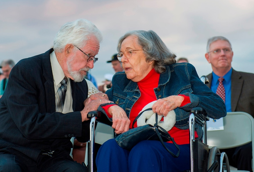 Dr. Sonny Witt speaks with Mrs. Betty Grissom at the Apollo 1 Memorial Ceremony held Jan. 27, 2014, at Launch Complex 34, Cape Canaveral Air Force Station, Fla. Witt is the 45th Space Wing director of operations for Detachment 1 and Grissom is the wife of Astronaut Gus Grissom. (U.S. Air Force photo/Matthew Jurgens)