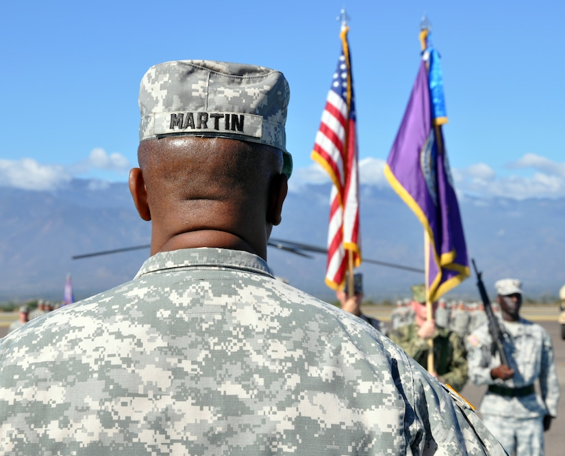 Joint Task Force-Bravo Command Sgt. Maj. Valmond A. Martin stands at attention during a retirement ceremony conducted in his honor at Soto Cano Air Base, Honduras, Jan. 29, 2014. Martin enlisted in the U.S. Army in 1983 and has served in for more than 31 years. (U.S. Air Force photo by Capt. Zach Anderson)