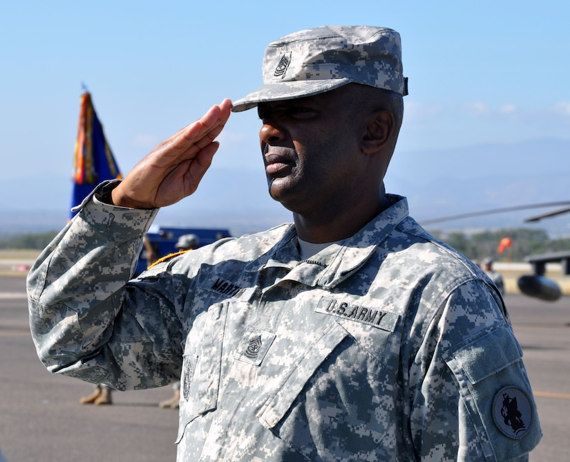Joint Task Force-Bravo Command Sgt. Maj. Valmond A. Martin salutes the U.S. flag during a retirement ceremony conducted in his honor at Soto Cano Air Base, Honduras, Jan. 29, 2014.  Martin enlisted in the U.S. Army in 1983 and served the United States for more than 31 years.  (Photo by Martin Chahin)