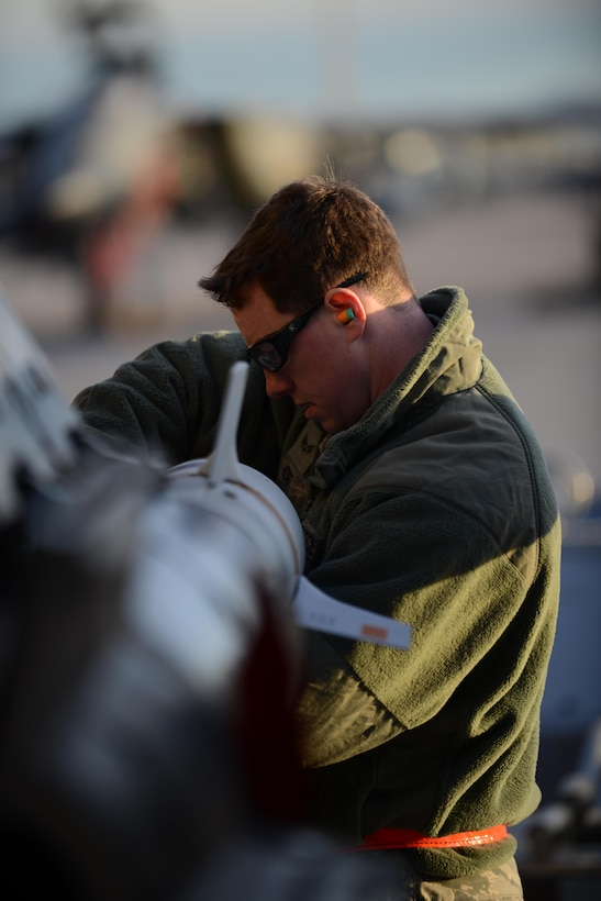 Senior Airman Jordan Gee adjusts the pins on an inert GBU-12 munition Jan. 28, 2014, at Nellis Air Force Base, Nev. Gee is one of more than 3,200 military members currently participating in Red Flag 14-1, a combat exercise that provides pilots with real-time war scenarios and helps ground crews test their readiness capabilities. Gee is a 366th Aircraft Maintenance Squadron weapons three man (U.S. Air Force photo/Senior Airman Benjamin Sutton)