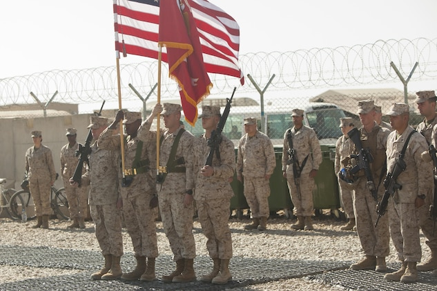 Marines with Combat Logistics Battalion 7 present organizational colors during a transfer of authority ceremony aboard Camp Leatherneck, Afghanistan, Jan. 26, 2014. The battalion replaced CLB-6 as the logistics combat element for Regional Command (Southwest) and will provide logistical support to units operating in Helmand province.