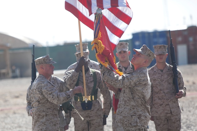 Lieutenant Col. Sidney R. Welch, right, commanding officer, Combat Logistics Battalion 7, uncases the battalion's battle colors during a transfer of authority ceremony aboard Camp Leatherneck, Afghanistan, Jan. 26, 2014. The battalion replaced CLB-6 as the logistics combat element for Regional Command (Southwest) and will provide logistical support to units operating in Helmand province.