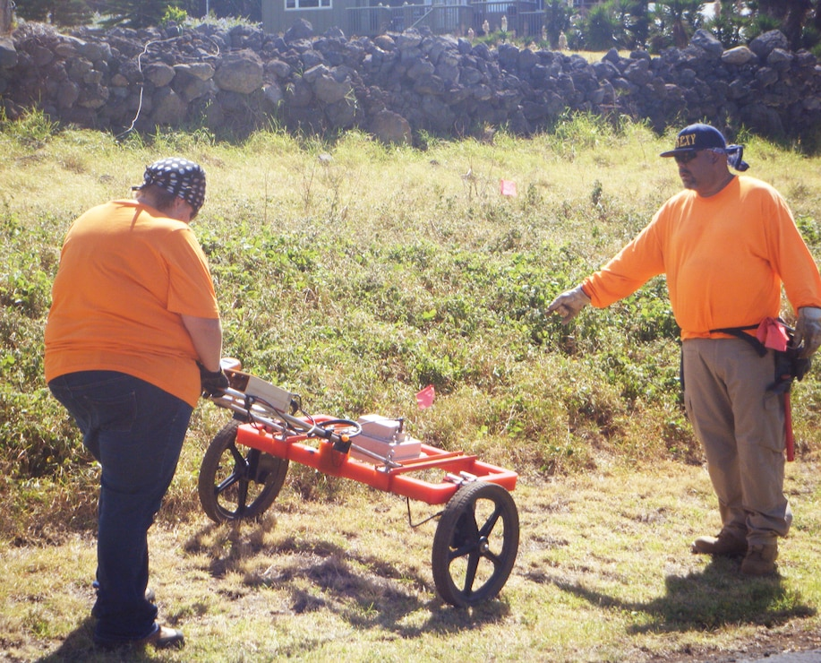 Waikoloa FUDS contract workers from Environet, Inc. use a ground penetrating radar to re-acquire and search for unexploded ordnance anomalies on the first day of a three-day ordnance investigation inside the Sandalwood Subdivision near Waimea on the island of Hawaii.