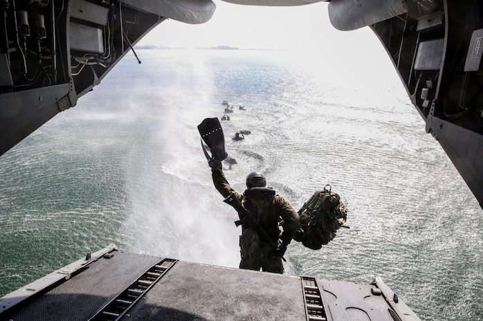 A soldier with the Japan Ground Self-Defense Force jumps out of a CH-46E Sea Knight while conducting Helo Cast training with 1st Reconnaissance Battalion, 1st Marine Division, during Exercise Iron Fist 2014 aboard Naval Amphibious Base Coronado, Calif., Jan. 27, 2014. Iron Fist is an amphibious exercise that brings together Marines and sailors from the 15th Marine Expeditionary Unit, other I Marine Expeditionary Force units, and soldiers from the JGSDF, to promote military interoperability and hone individual and small-unit skills through challenging, complex and realistic training. (U.S. Marine Corps photo by Cpl. Emmanuel Ramos/Released)