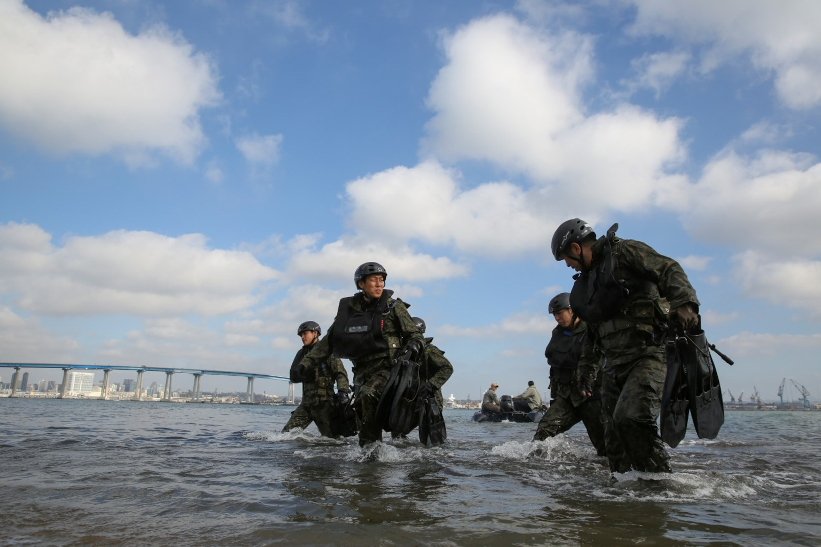 Soldiers with the Japan Ground Self-Defense Force make their way onto Seal Beach while conducting Helo Cast training with 1st Reconnaissance Battalion, 1st Marine Division, during Exercise Iron Fist 2014 aboard Naval Amphibious Base Coronado, Calif., Jan. 27, 2014. Iron Fist is an amphibious exercise that brings together Marines and sailors from the 15th Marine Expeditionary Unit, other I Marine Expeditionary Force units, and soldiers from the JGSDF, to promote military interoperability and hone individual and small-unit skills through challenging, complex and realistic training. (U.S. Marine Corps photo by Cpl. Emmanuel Ramos/Released)