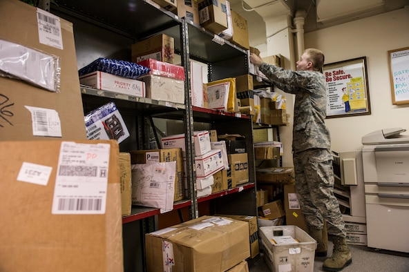 U.S. Air Force Senior Airman Joseph McConnell, 354th Communications Squadron knowledge operations management journeyman, looks for a package Jan. 21, 2014, Eielson Air Force Base, Alaska. Sorting dorm residents' mail is one of many tasks knowledge operations managers complete daily. (U.S. Air Force photo by Senior Airman Joshua Turner/Released)