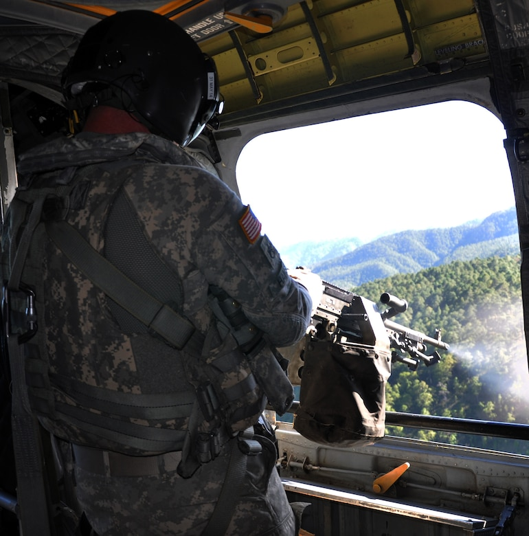 U.S. Army Sgt. Shelby Hansen, a flight engineer and unit gunnery trainer assigned to Joint Task Force-Bravo's 1-228th Aviation Regiment, fires an M240 machine gun from a CH-47 Chinook helicopter during aerial gunnery training, Jan. 29, 2014.  Members of the 1-228th conduct aerial gunnery training regularly in order to maintain currency and proficiency on the weapon system.  (U.S. Air Force photo by Capt. Zach Anderson)